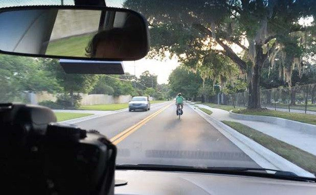 seeing a cyclist in front of you while driving - cropped